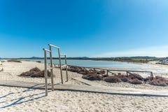 Landscape of the beach of Le Saline. In north sardinia, in a sunny day, water, nature, sea, blue, sky, beautiful, coast, coastline, seascape, sand, shore royalty free stock photo