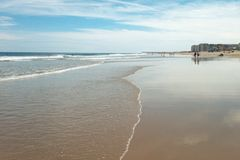 Landscape of beach. Beach on a sunny day with water, waves, and sand Stock Photography