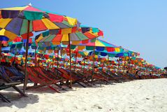 A landscape of the beach and Beach umbrella. Beach chair with white sand and blue sky Royalty Free Stock Photography