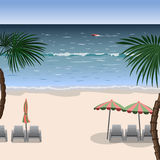 Landscape of a beach with white sand, sea. Landscape of a beach with white sand, sea, umbrellas, loungers and palm trees Royalty Free Stock Photo