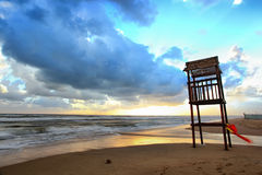 Landscape of beach with the wooden lookout tower Stock Photo