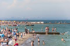 Landscape. Beaches with resting and swimming people. The horizon line. Sunny day. Odessa City, Ukraine, May 2019, summer, america, architecture, beautiful royalty free stock photos