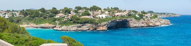 Landscape of the beautiful bay of Cala Mandia with a wonderful turquoise sea,Porto Cristo, Majorca, Spain. Summer time Stock Photos