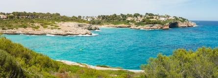Landscape of the beautiful bay of Cala Mandia with a wonderful turquoise sea,Porto Cristo, Majorca, Spain. Summer time Stock Image