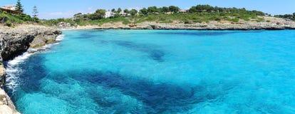 Landscape of the beautiful bay of Cala Mandia with a wonderful turquoise sea,Porto Cristo, Majorca, Spain. Summer time Stock Photo