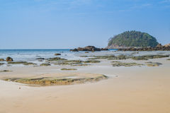 Landscape with beautiful beach against seaview with rocks and a cloudy sky at kata beach, Phuket, Thailand Royalty Free Stock Image