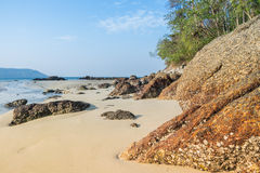 Landscape with beautiful beach against seaview with rocks and a cloudy sky at kata beach, Phuket, Thailand Royalty Free Stock Photos