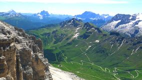 Landscape of the beautiful Dolomites the limestone mountains of the Italian Alps. At The Marmolada Group at Pordoi Pass in Belluno Italy in summer stock footage