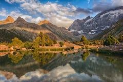 Landscape of beautiful Fan mountains and Kulikalon lake in Tajikistan. On blue cloudy sky background stock photography
