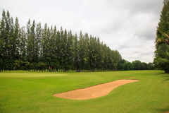 Landscape of a beautiful green golf course with sky Stock Images