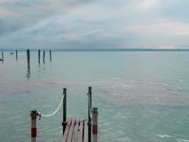 Landscape of the beautiful lake Garda, Sirmione. With birds. stock photos