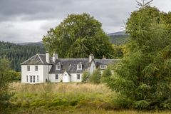Beautiful old big rural house in scotland. Landscape with beautiful old big rural house in scotland Stock Photos
