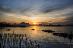 Landscape of beautiful sunrise at fisherman village in Thailand Stock Photo