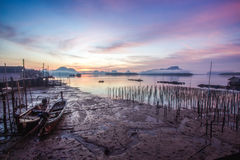Landscape of beautiful sunrise at fisherman village in Thailand Royalty Free Stock Photos
