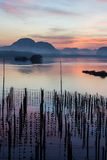 Landscape of beautiful sunrise at fisherman village in Thailand Royalty Free Stock Photo
