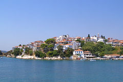 Landscape of beautiful white houses on the rocky peninsula of the Skiathos Town Stock Photography
