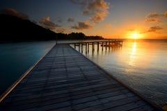 The landscape of beautiful wooden bridge with sunrise Stock Photo