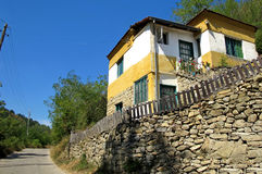 Landscape of a beautiful yellow and white village house Stock Image