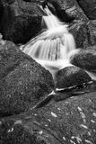 Landscape of Becky Falls waterfall in Dartmoor National Park Eng Stock Photos
