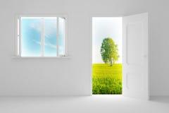 Landscape behind the open door and window. Stock Photo