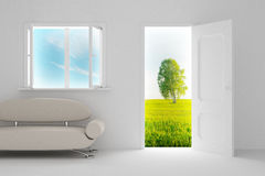 Landscape behind the open door and window. Stock Photo