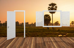 Landscape behind the opening door and window Stock Images