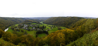 Landscape in the Belgian Ardennes in Autumn. The village of Rochehaut in a valley of the Lesse river in the Belgian Ardennes during autumn, the scenery of the stock images