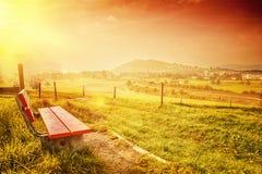 Landscape of a bench in autumn season Stock Photos