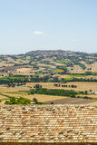 Landscape beyond a tiled roof Stock Image