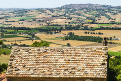 Landscape beyond a tiled roof Stock Photos