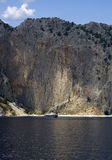 Landscape - Big Rock And Small Boat Royalty Free Stock Photos