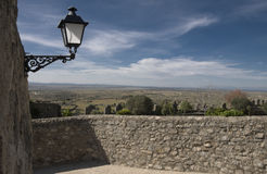 Landscape with big sky, Spain. Stone wall & ornate lamp fgnd of pano rural landscape Trujillo, Spain Royalty Free Stock Image