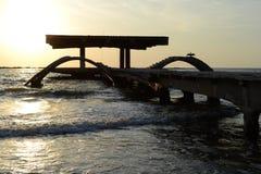 Landscape, Black Sea sunrise, old pontoon. royalty free stock photography
