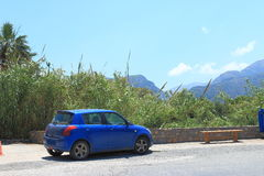Landscape with a blue car Royalty Free Stock Photo