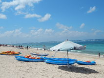 Landscape of blue Kayaks and white big umbrella Royalty Free Stock Photography