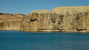 Landscape of blue lake coastline. Band-e Amir Lakes. Band-e Amir National Park, Bamyan Province, Afghanistan. Pan right. wide shot stock video
