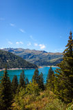 Landscape with blue mountain lake in the Alps. Royalty Free Stock Photos