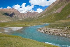 Landscape of blue river and mountains, Tien Shan Royalty Free Stock Image