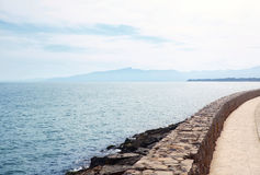 Landscape of blue sea or ocean and stone path Stock Photo