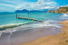 Landscape with blue sea and sand coast royalty free stock photo