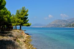 Landscape with blue sea, trees and mountains stock images