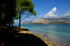Landscape with blue sea, trees and mountains stock photography