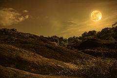 Landscape of blue sky with cloud and beautiful full moon. Sepia. Landscape of blue sky with cloud and beautiful full moon over tranquil nature background royalty free stock image