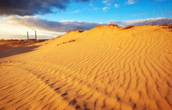 Landscape with blue sky, dunes and power plant. Stock Images