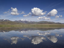 Landscape with blue sky, white clouds and mountain lake. Mongoli Royalty Free Stock Photography