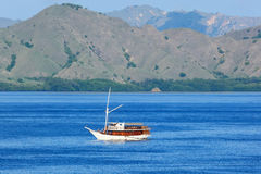 Landscape with the boat, Komodo island - Indonesia Stock Photo