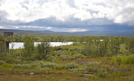 Landscape with a boat in norsk tundra Royalty Free Stock Images
