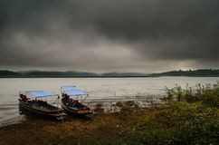 Landscape with boat and sea under the rain and cloudy sky in the. Evening Royalty Free Stock Photos