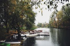 Landscape at the boat station. Beautiful autumn landscape at the boat station, boats, river and trees Royalty Free Stock Photo