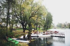 Landscape at the boat station. Beautiful autumn landscape at the boat station, boats, river and trees Stock Photo